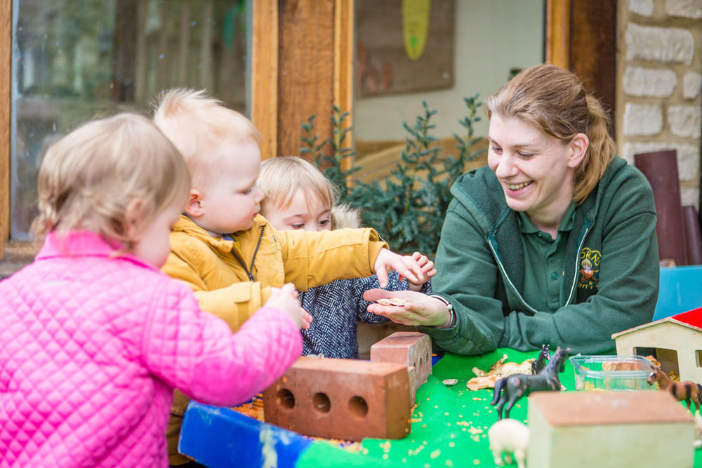 Some of the babies playing outside at Acorns Nursery School Cirencester.