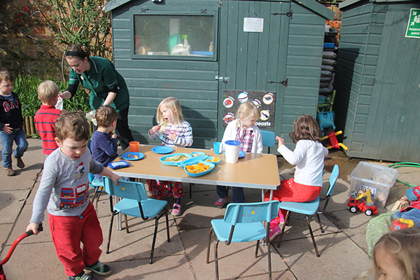 Eating outside at Acorns Nursery School in Cirencester.