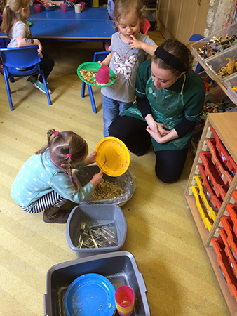 Clearing the plates at Acorns Nursery School Cirencester.