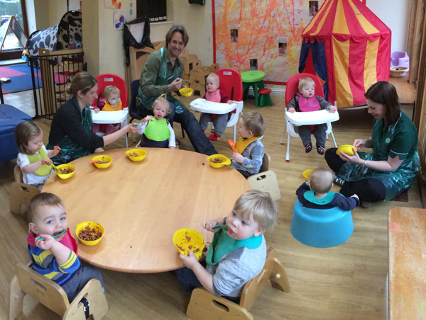 Feeding the babies at Acorns Nursery School, Cirencester.