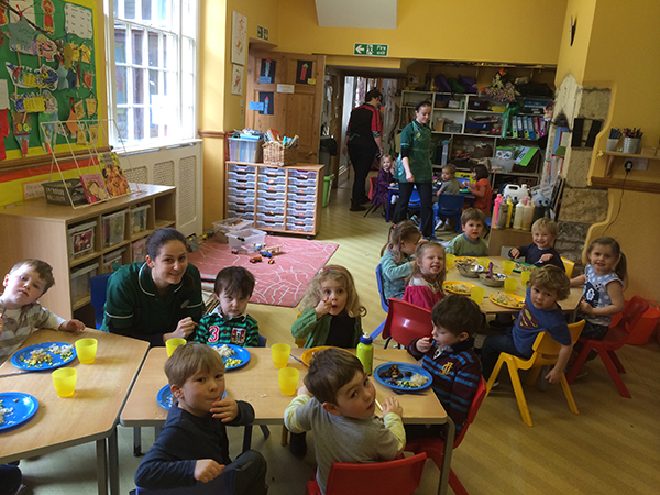The pre-school enjoying their lunch Acorns Nursery School in Cirencester.