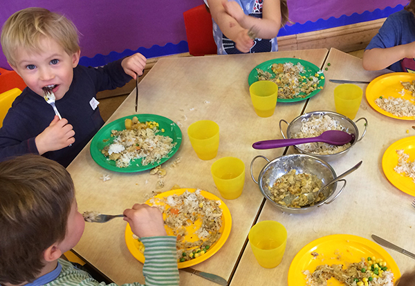 The pre-school eating their lunch Acorns Nursery School in Cirencester.
