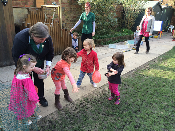 Children helping to seed the main lawn.