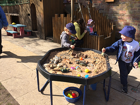 Playing in the garden at Acorns Nursery School, Cirencester.