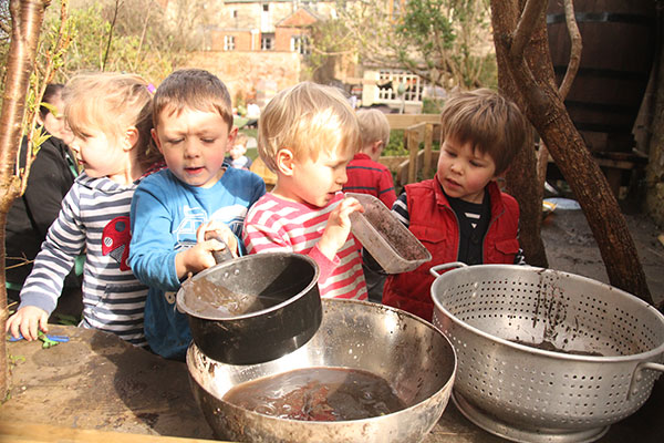 The mud kitchen in the garden at Acorns Nursery School Cirencester