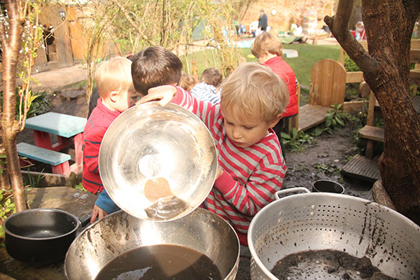 The mud kitchen in the garden at Acorns Nursery School Cirencester