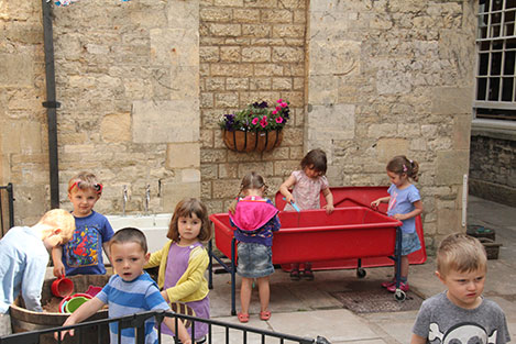 Clematis blooms over the Preschool Courtyard Classroom at Acorns Nursery School Cirencester.