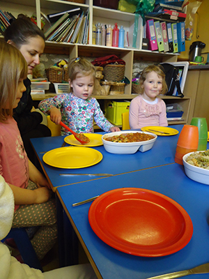 Serving the pasta at Acorns Nursery School, Cirencester.