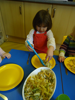 Serving up the pasta at Acorns Nursery School, Cirencester.