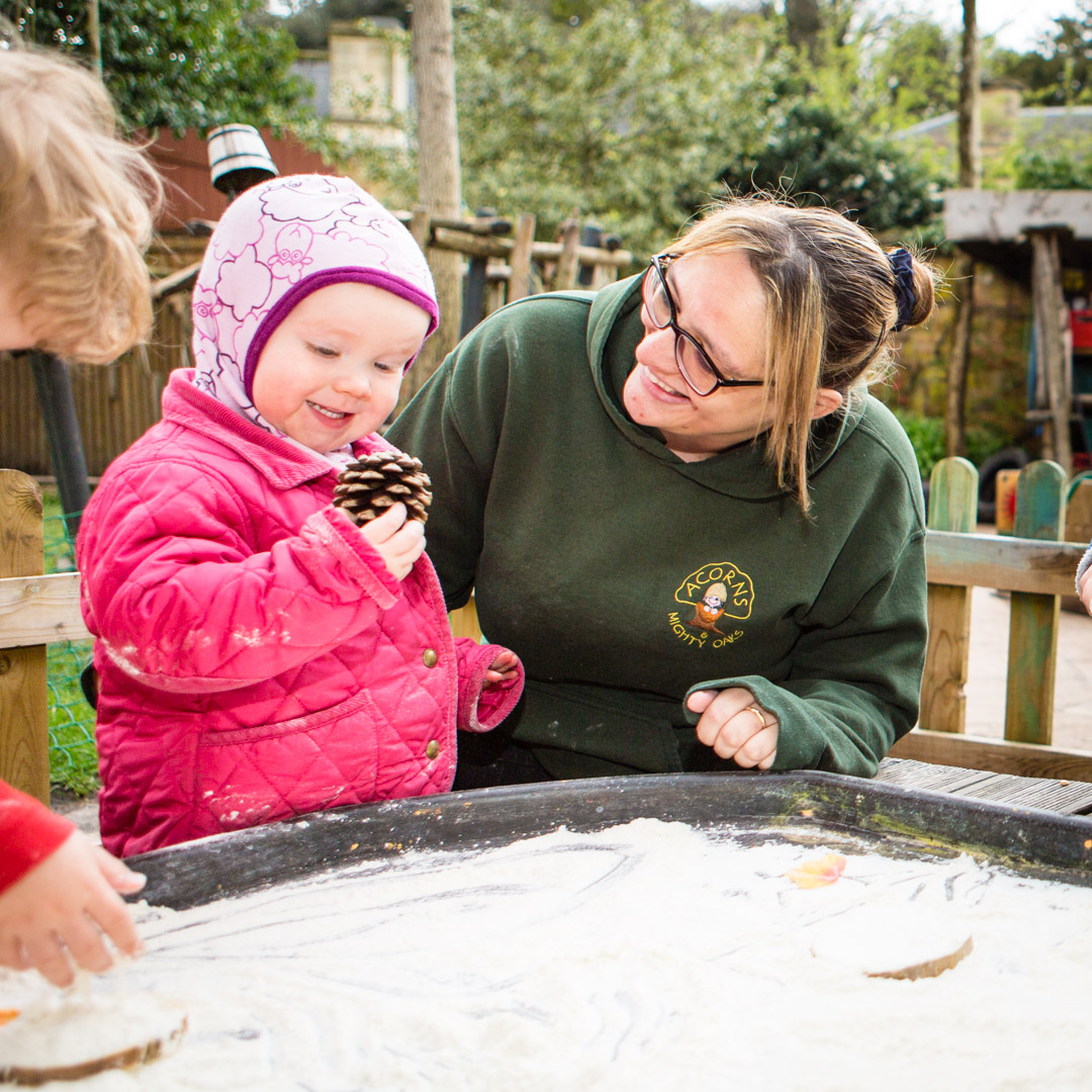 Playing outside at Acorns Nursery Cirencester