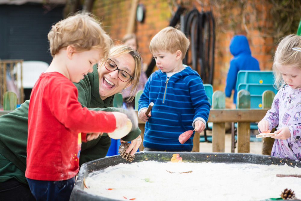 Some of the Toddlers playing outside at Acorns Nursery Cirencester