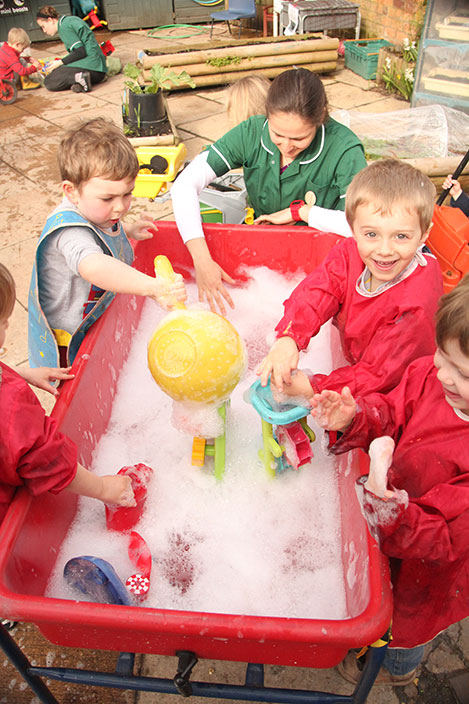 Water fun at Acorns Nursery School, Cirencester.
