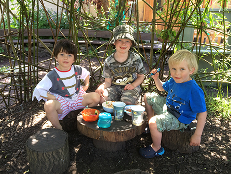 Eating in the Willow House in the garden at Acorns Nursery School Cirencester